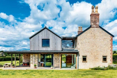 Timber-clad extension to an old cottage