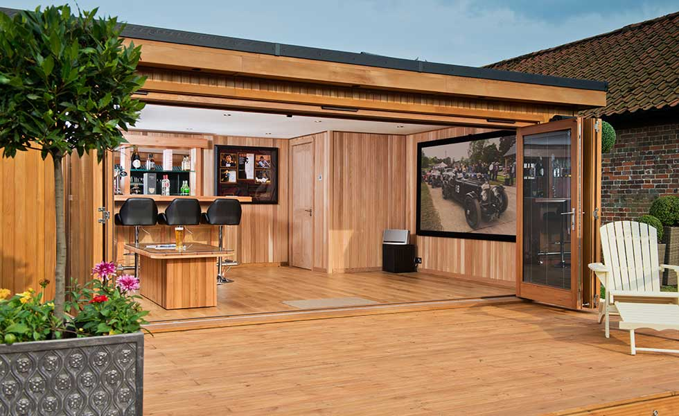 This outbuilding has been given over to a cinema and outdoor bar