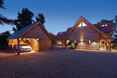 This outbuilding acts as a carport and store to the main house