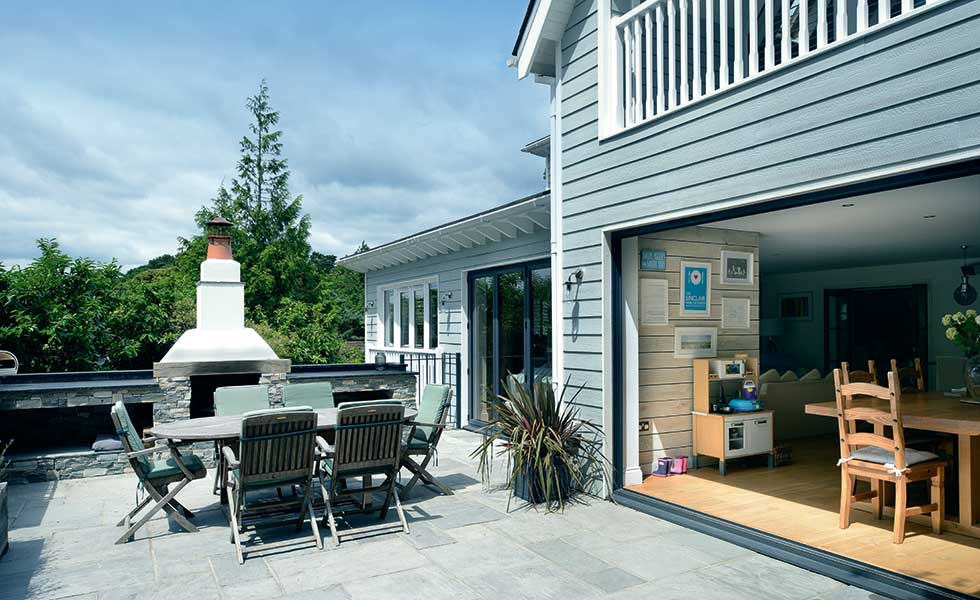 Bifold doors open out onto a BBQ deck perfect for outdoor entertaining