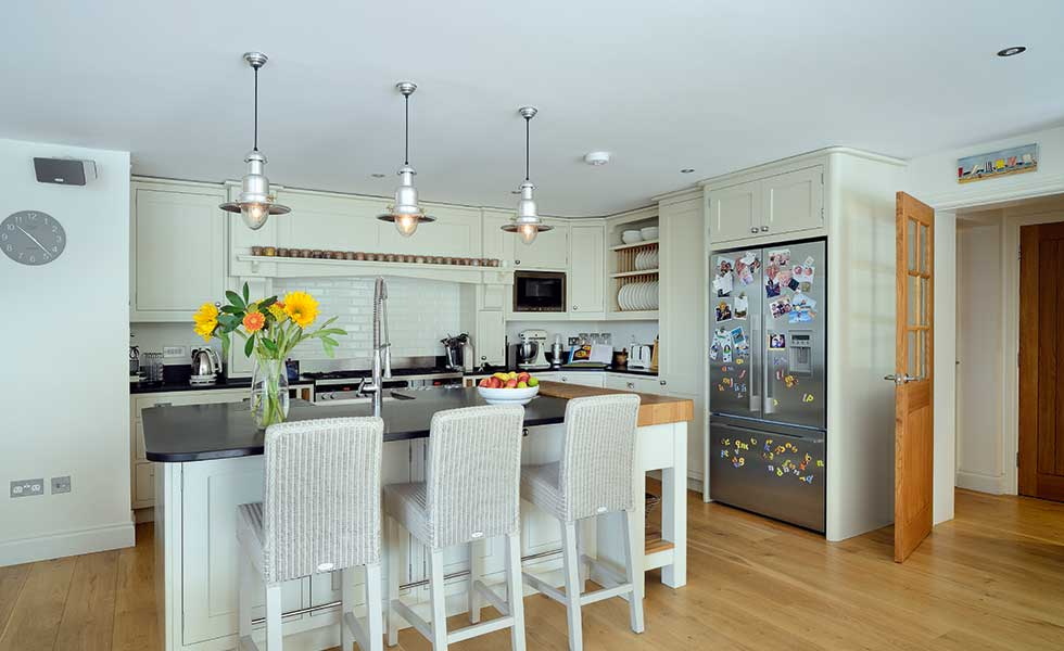 The open plan kitchen is the heart of the home. A large centre island doubles as a breakfast bar
