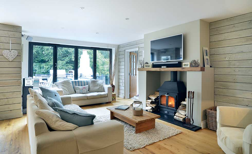 While a separate living space offers more private relaxing space, the family area within the open plan kitchen diner is an inviting space complete with a woodburning stove which acts as a focal point