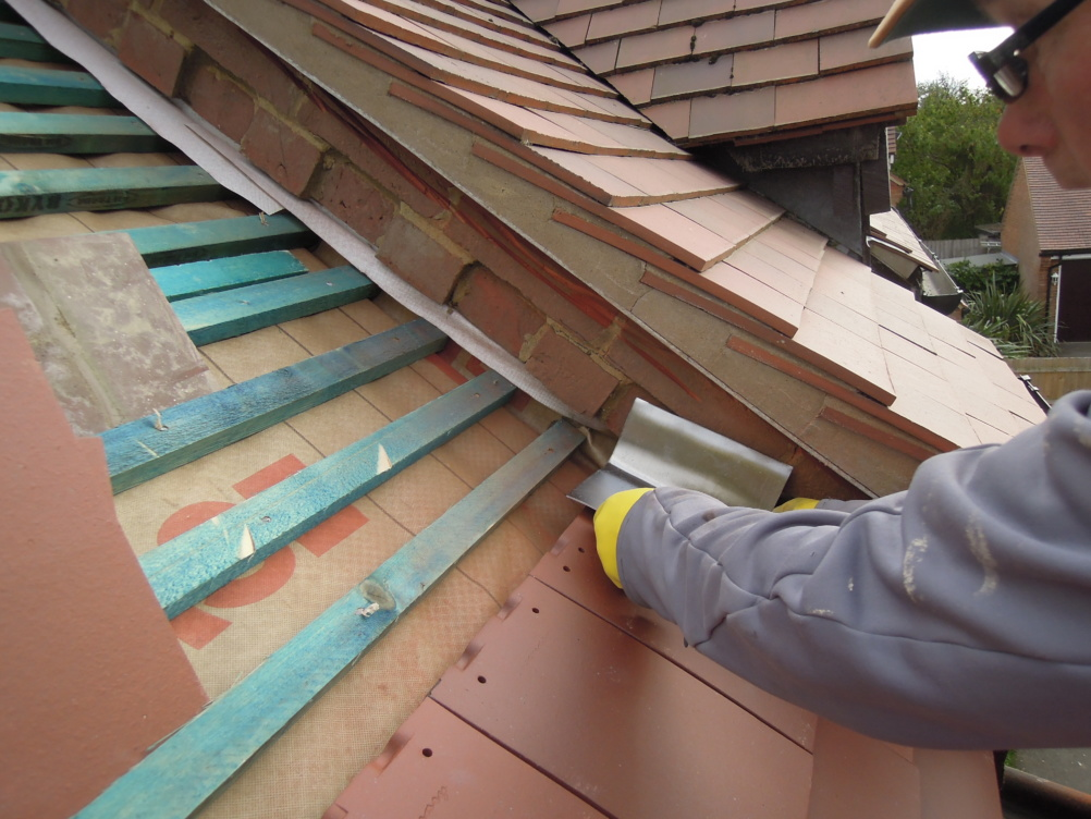 lead soakers fitted to tiles on roof of extension