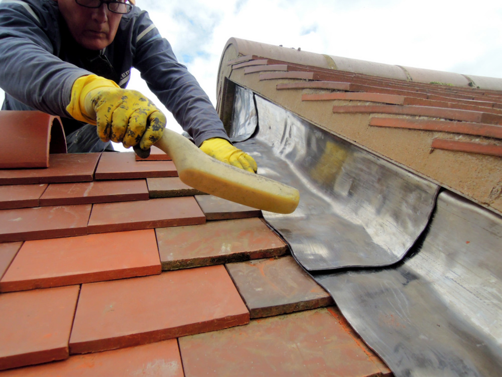 bossing of flashes on tiled roof