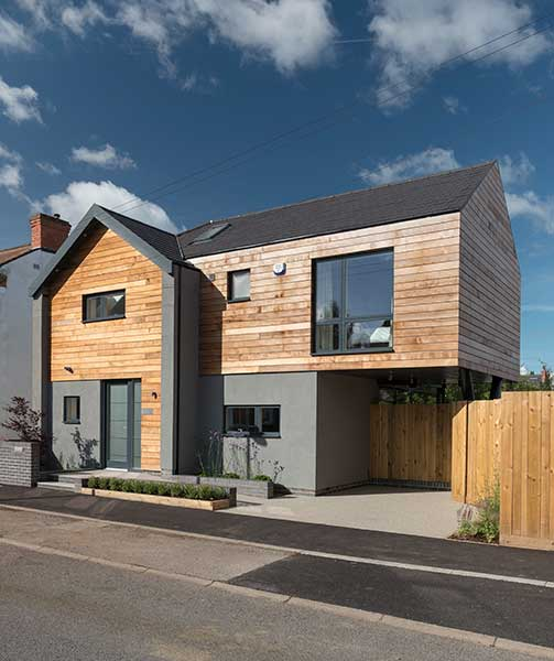 This contemporary new home has been clad in timber and render