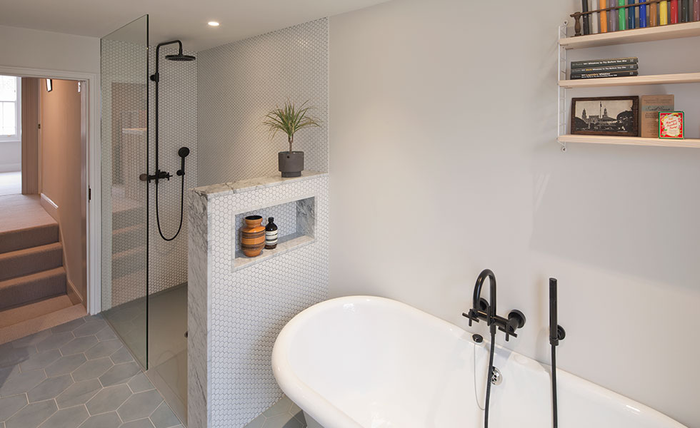 bath and shower decorated with white tiles and marble