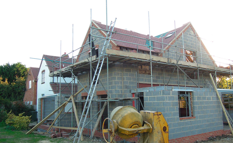 extension exterior with roof and scaffolding