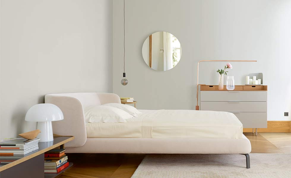 Modern bedroom with bed from Ligne Roset