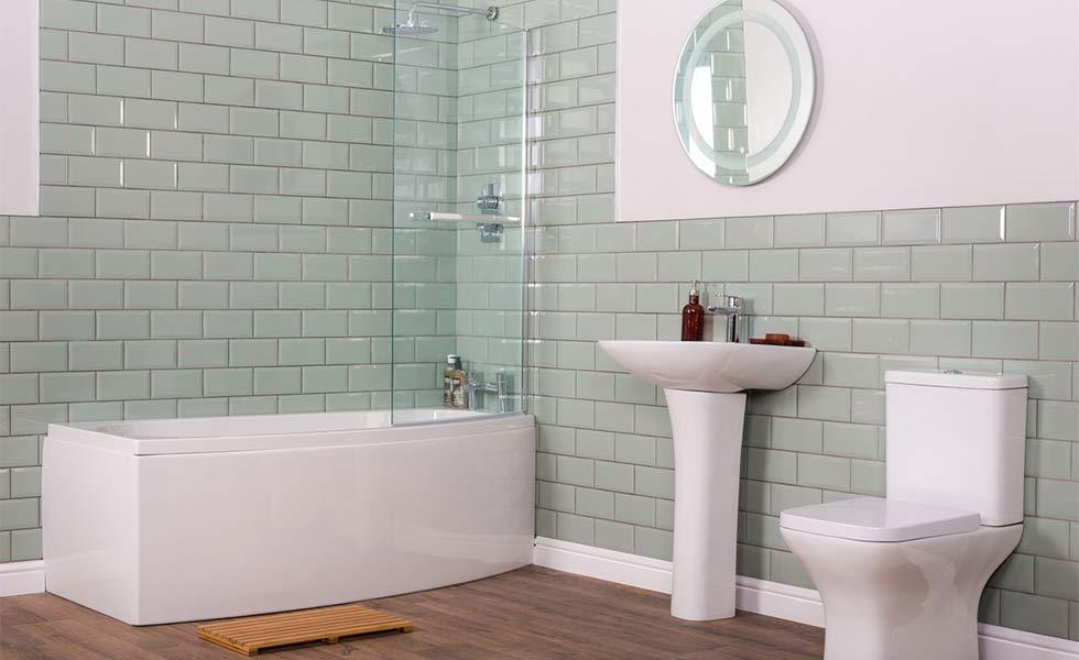 White bathroom with curved bath