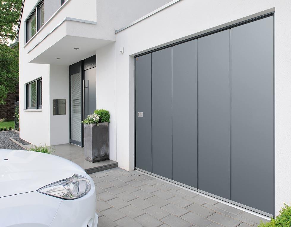Side sliding sectional garage door