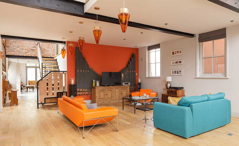 Living room in chapel conversion with double height ceilings