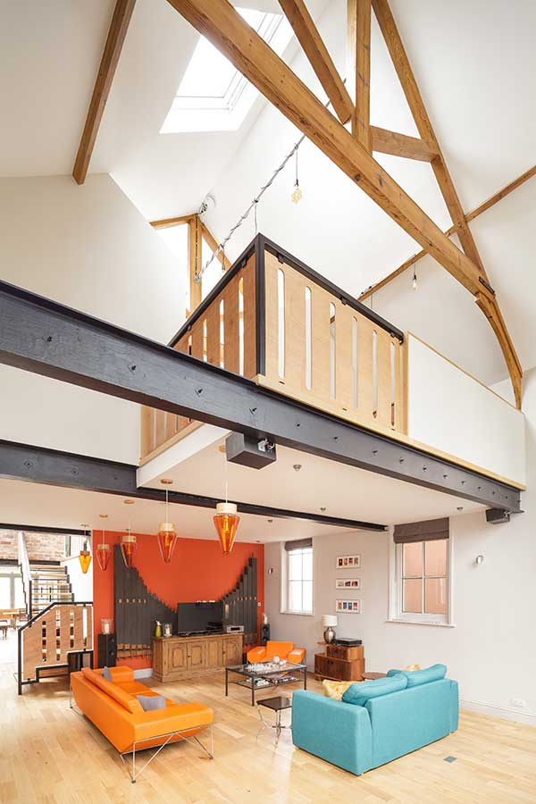 Double height living space with mezzanine office
