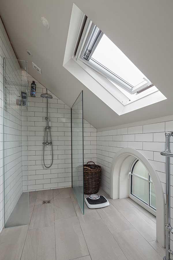 En suite bathroom with sloping ceiling