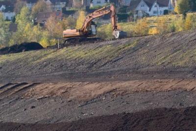 digger on contaminated land