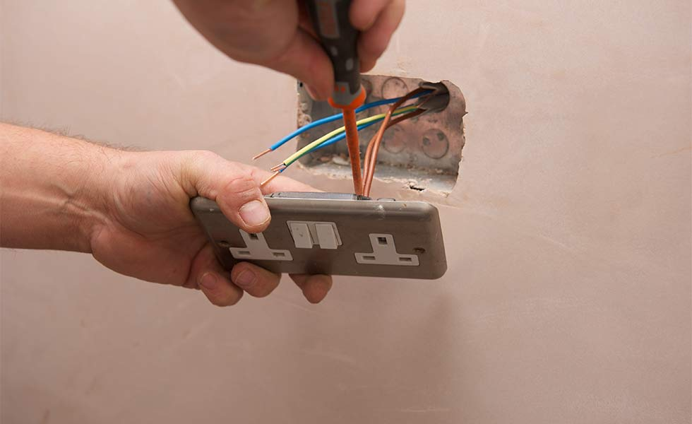 Electrician fitting a socket
