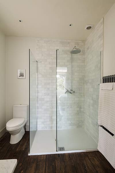 New bathroom with glass shower enclosure