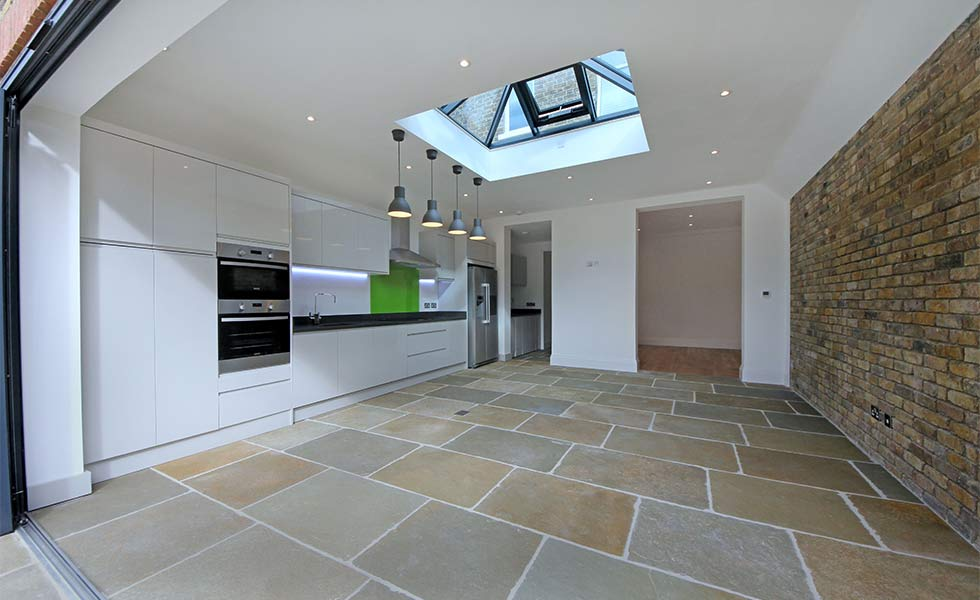 New kitchen with stone flooring and roof lantern