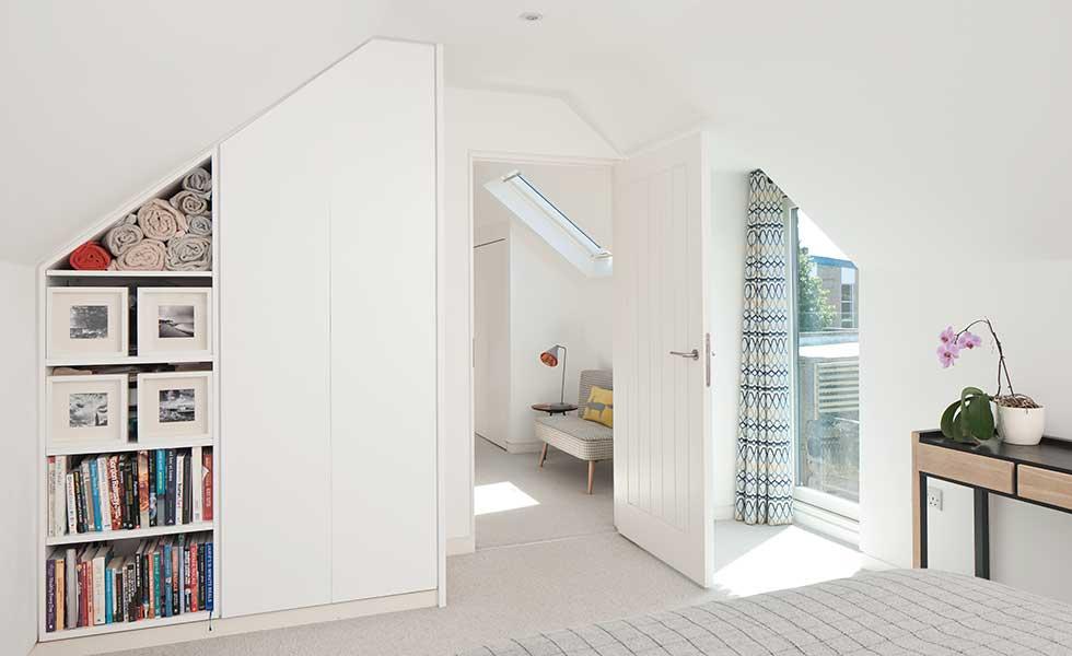 built-in-storage-in-bedroom-with-vaulted-ceilings