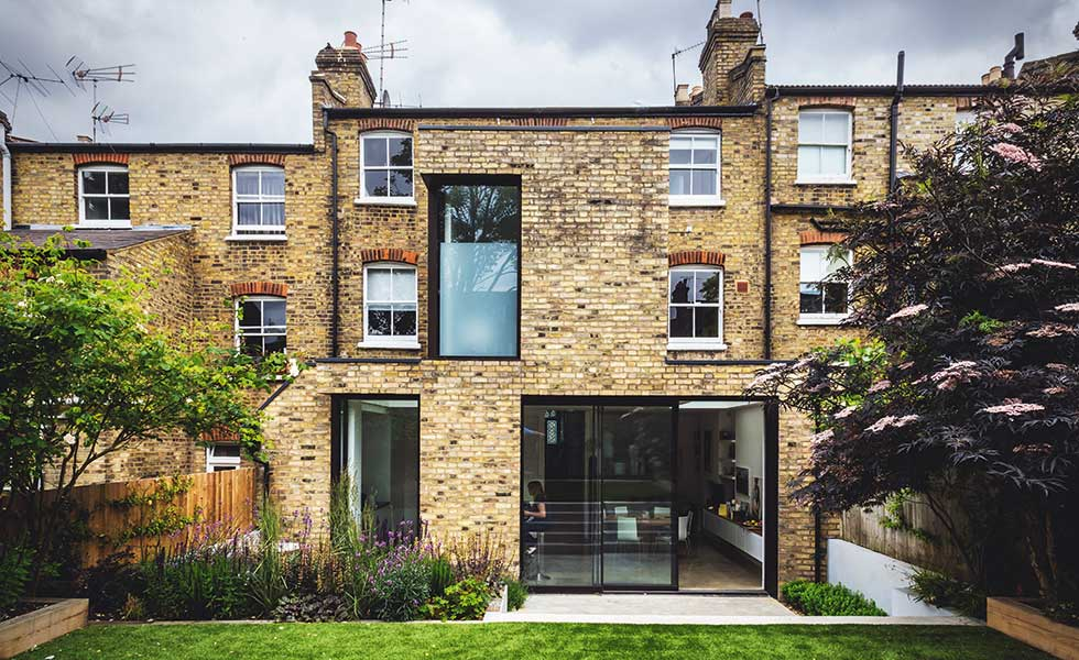 Clad in brick to match the existing, this two storey extension offers additional accommodation to this terrace home