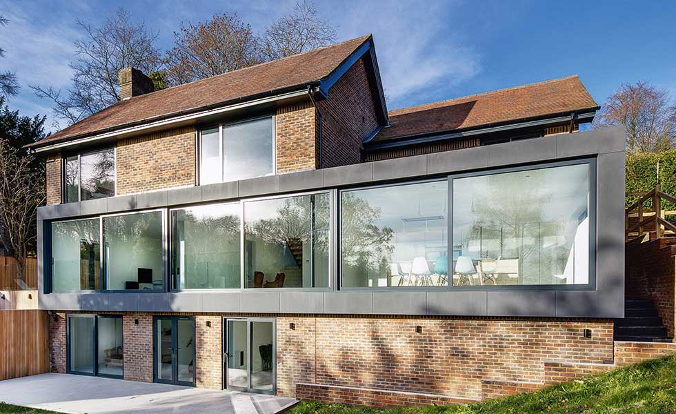 This two storey extension designed by AR Design Studio adds contemporary flair to a traditional brick building