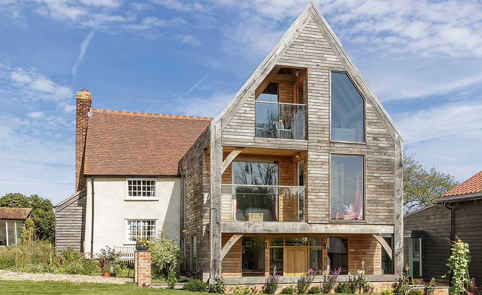 This triple storey oak frame extension by Oakwrights offers much needed additional space