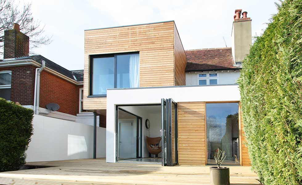 A cantilevered two storey timber clad extension