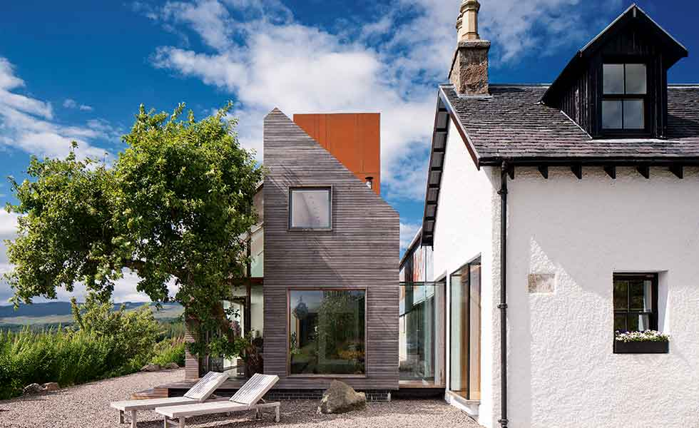 A cottage has been extended with a contemporary new two storey structure