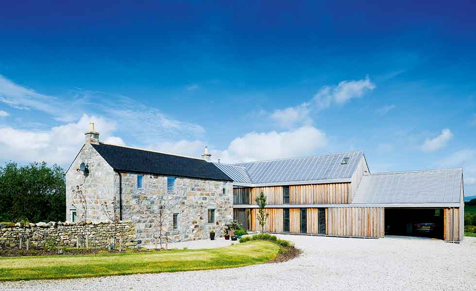 A two storey timber clad extension has been added as a separate wing onto this farm building