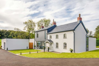 House clad with slate tiles and render
