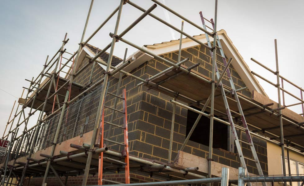 Brick extension to house with scaffolding