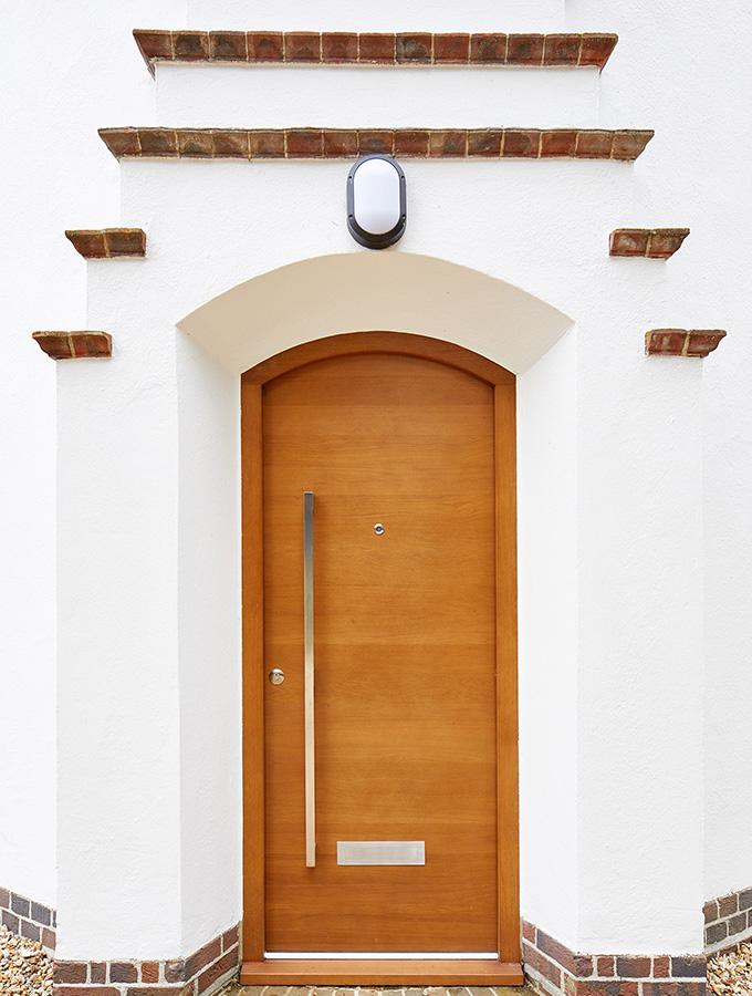 modern wooden door in rendered house