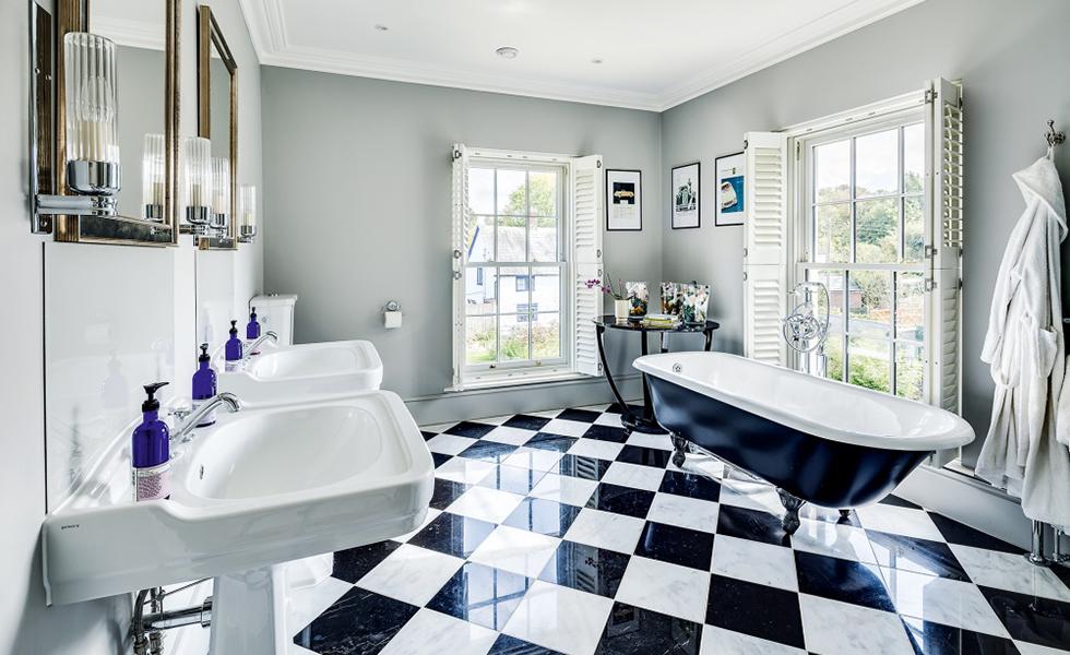 bathroom with sash windowsin traditional style