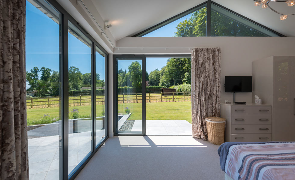 Bringing light into the bedroom with bifold doors and fixed glazing