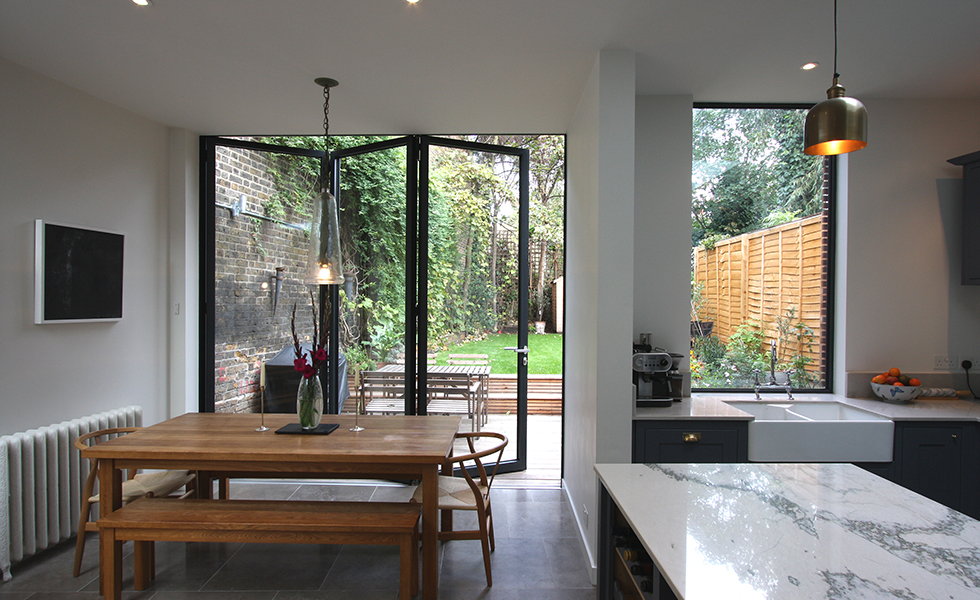 modern kitchen with partially opened bifold doors