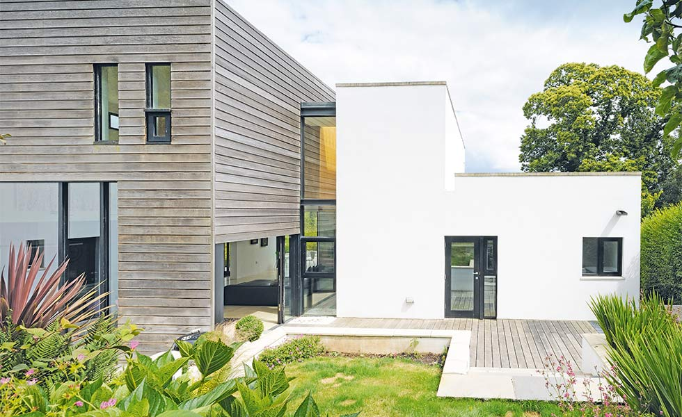 Contemporary self build with glass and render