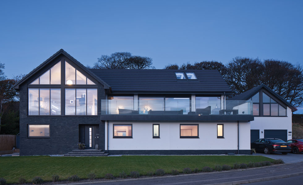 this timber frame house on the Scottish coast is filled with natural light