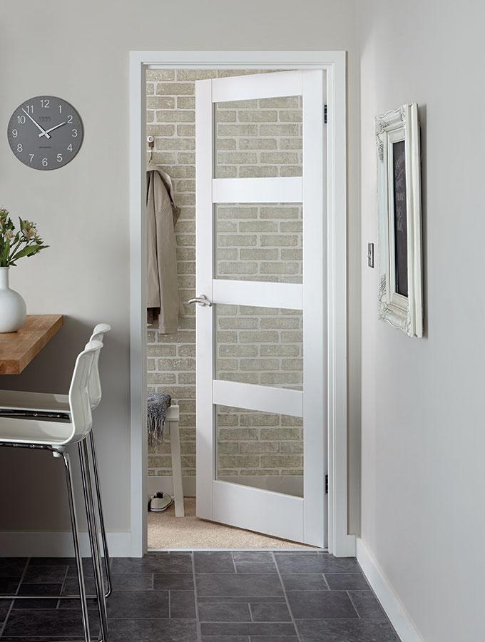 glass and wood panel door in kitchen