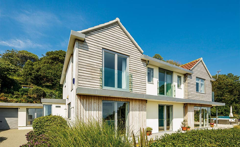 Coastal renovation clad in weatherboarding and render
