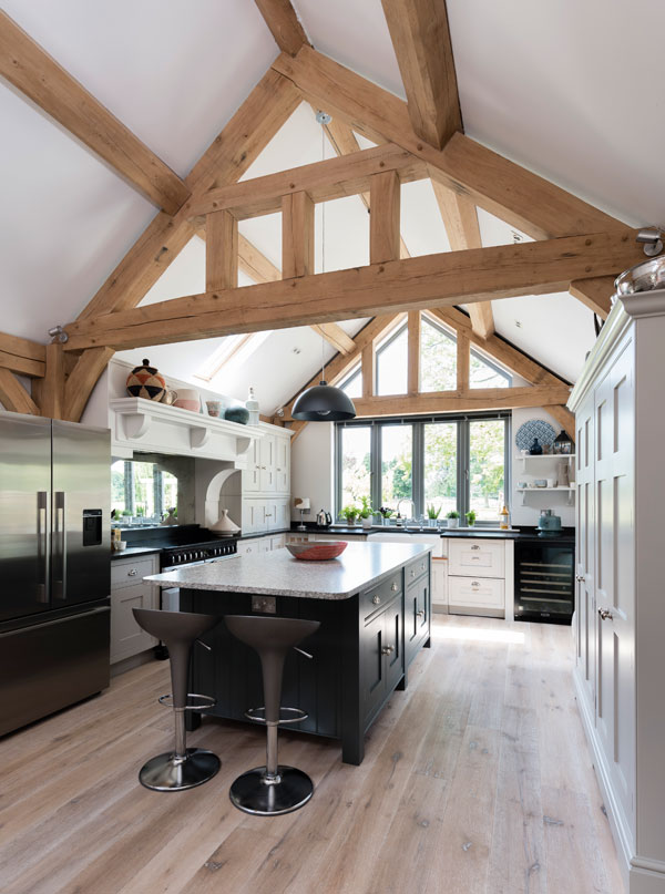 Vaulted ceiling with exposed oak frame in kitchen