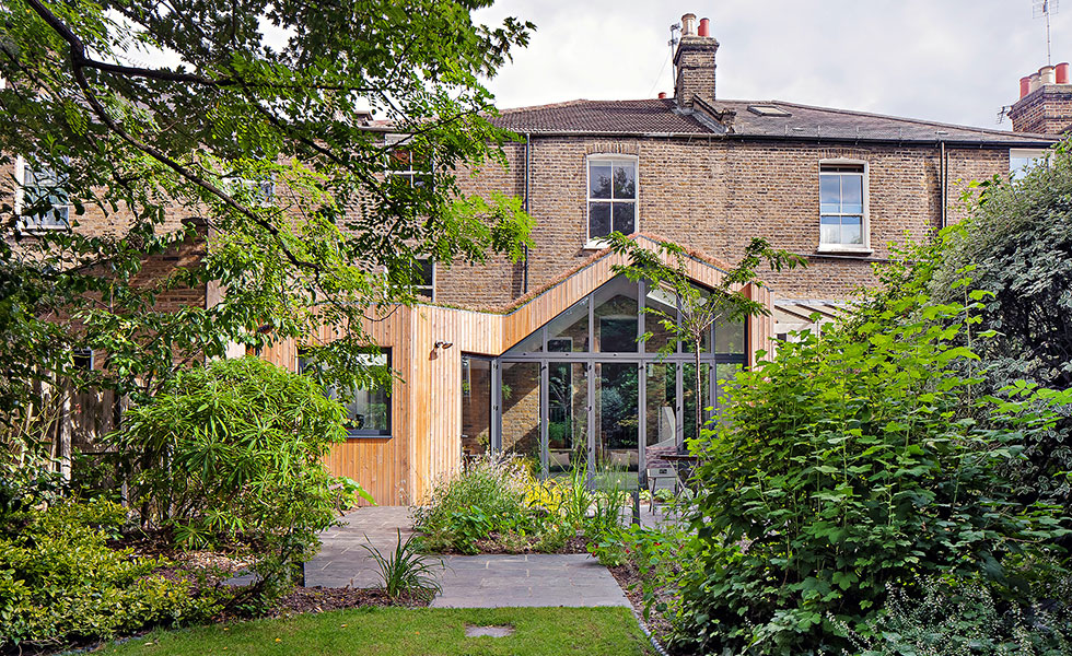 wood clad extension with contemporary bifolding doors