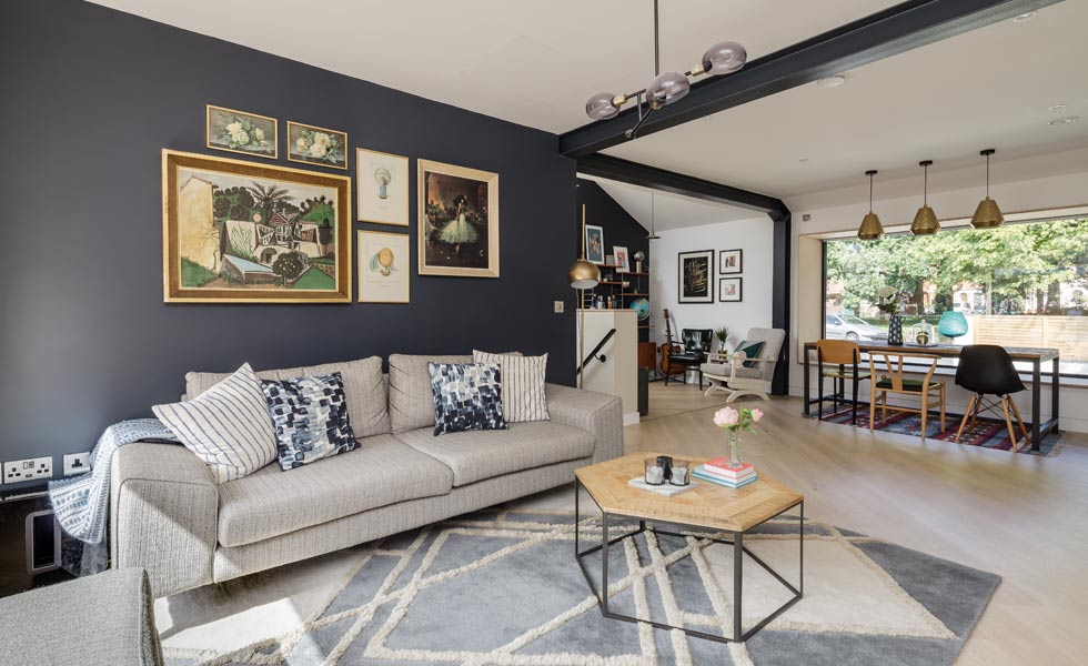 open plan living room with dark blue wall