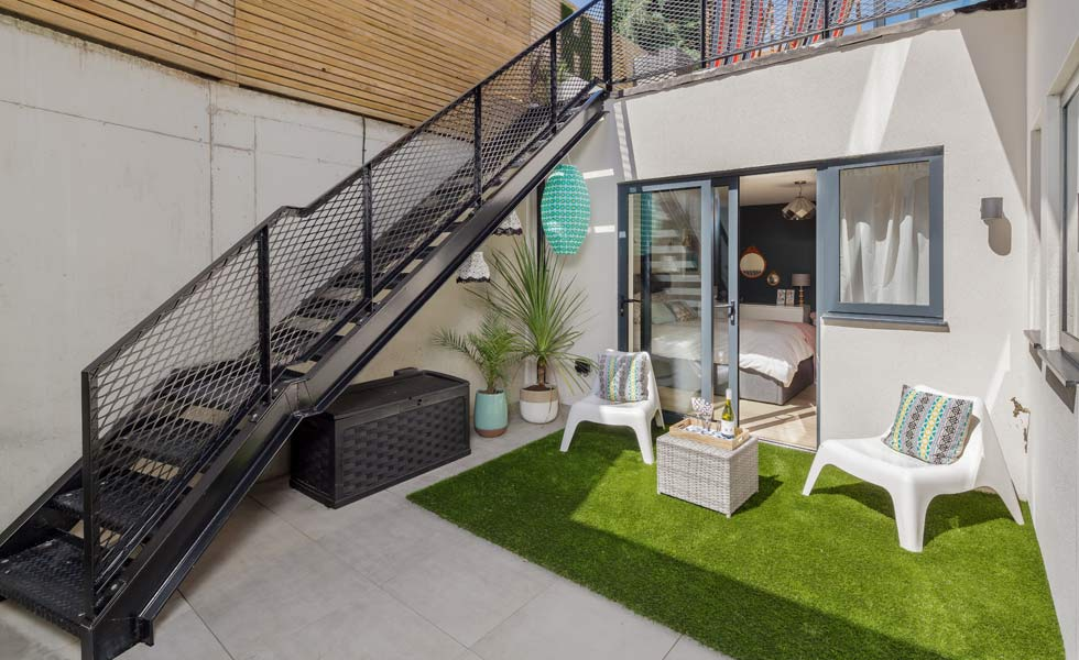 industrial style stairs down to basement level courtyard