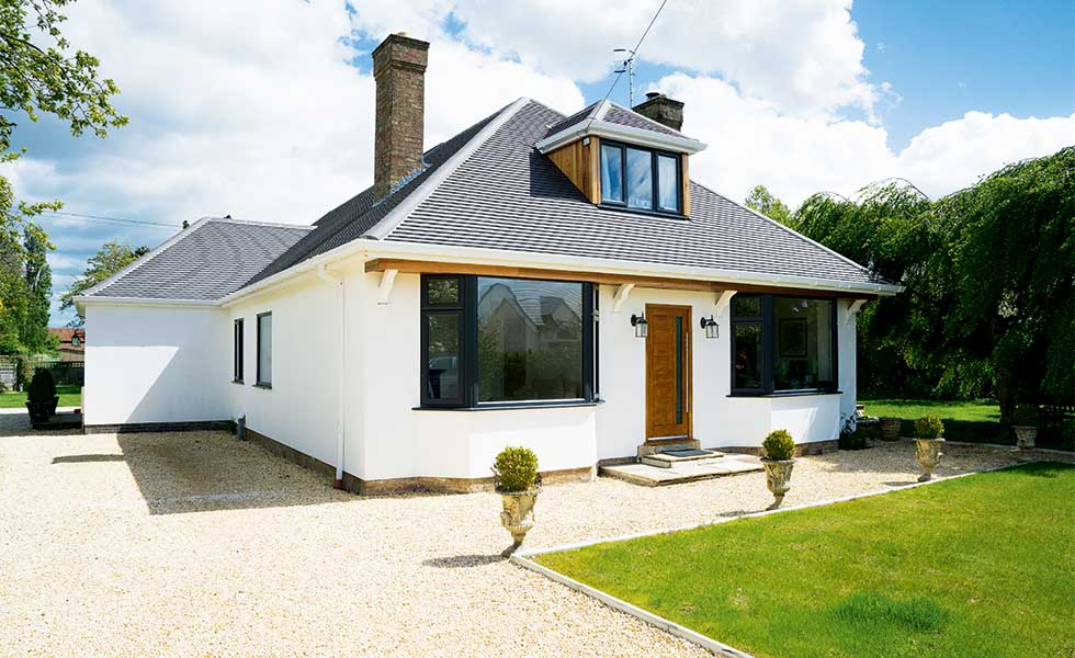 Dormer bungalow renovation with white render
