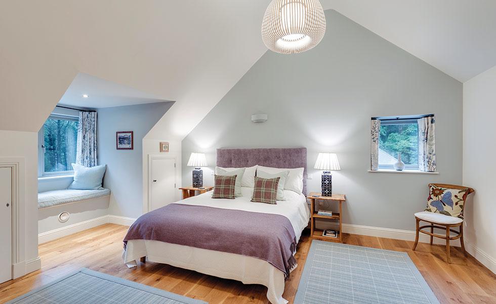 bedroom in house with dormer window