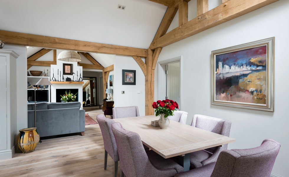 exposed oak frame and lime-washed oak floor in dining room