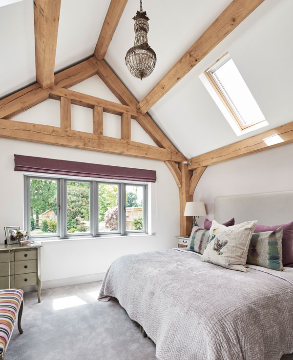 oak timbers frame the bed in the master bedroom