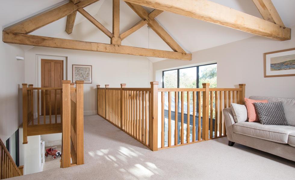 Mezzanine snug or study area with exposed oak trusses