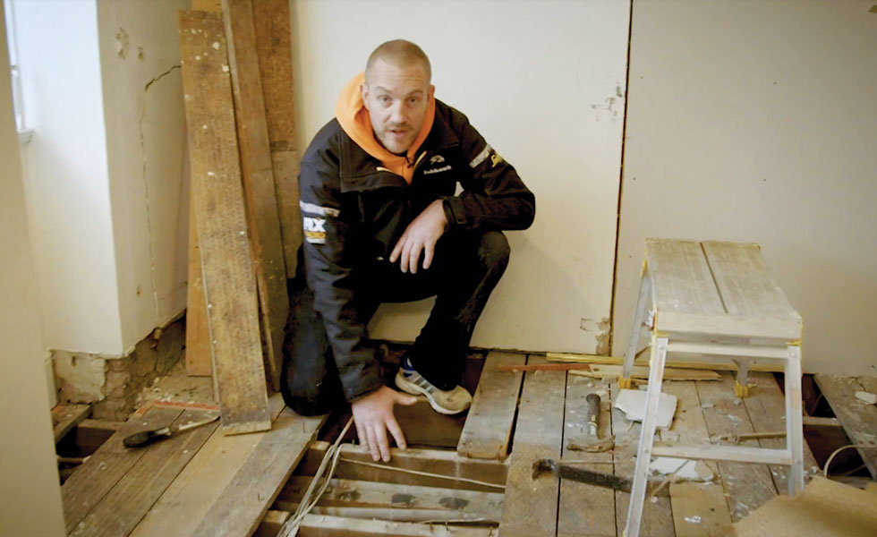 pulling up floorboards to prep for installing a wetroom