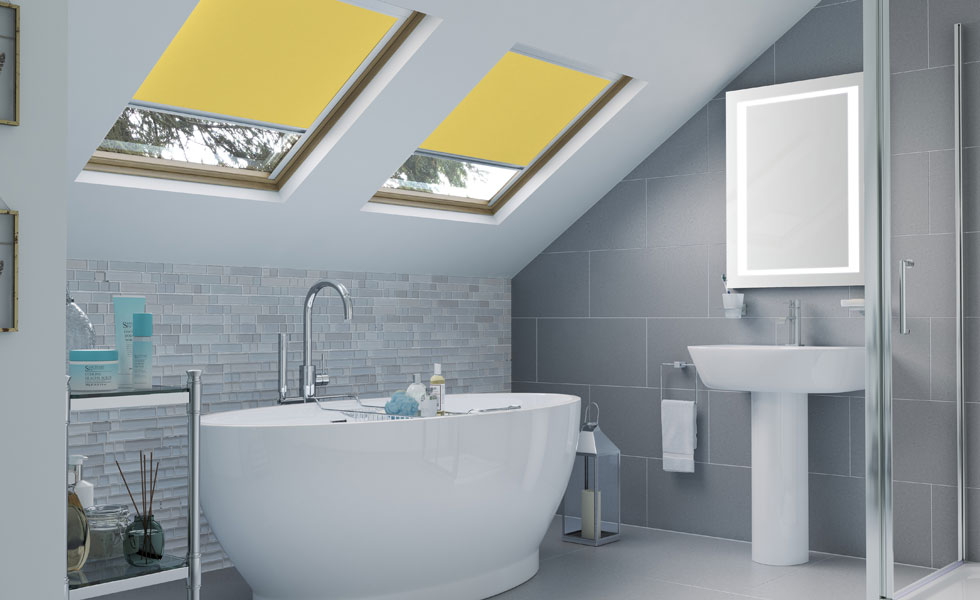 bathroom suite with sloping ceiling and rooflights with yellow blinds