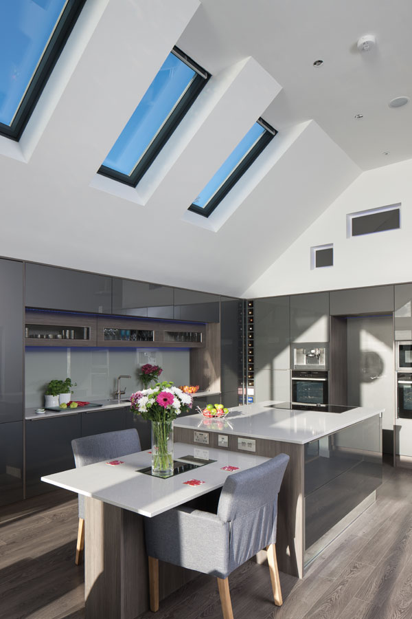 Rooflights flood the contemporary kitchen with natural light